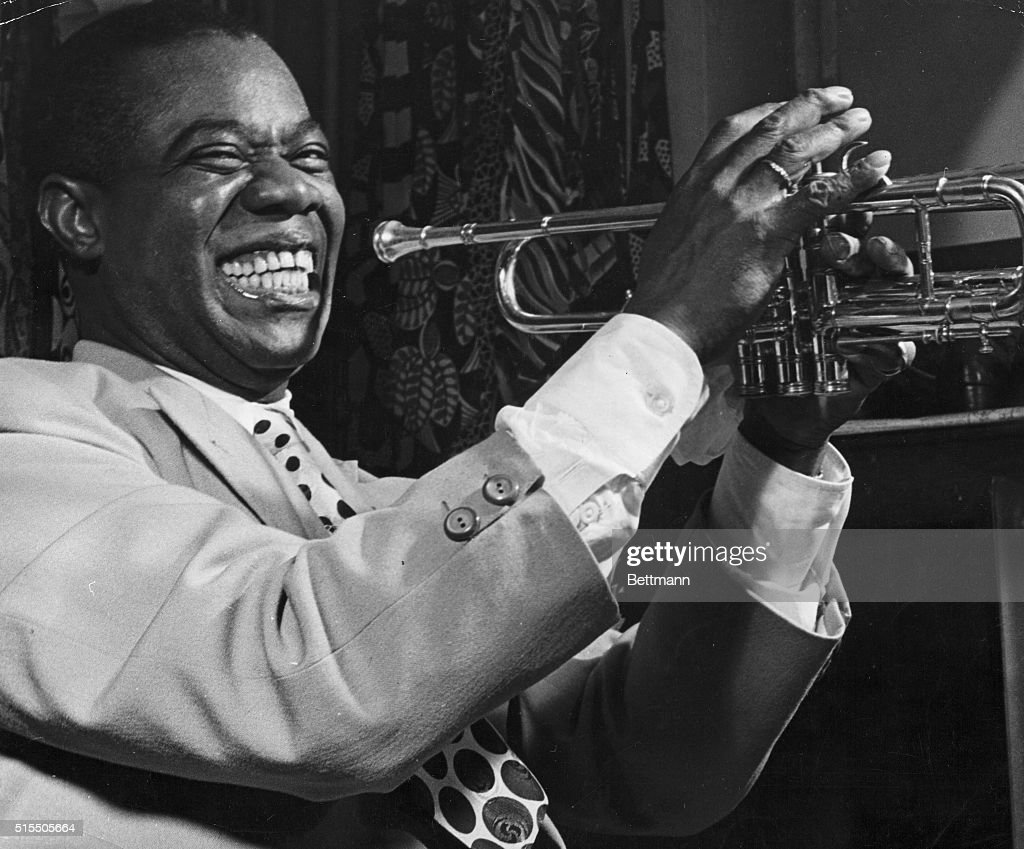 Louis Armstrong Holding Trumpet : News Photo