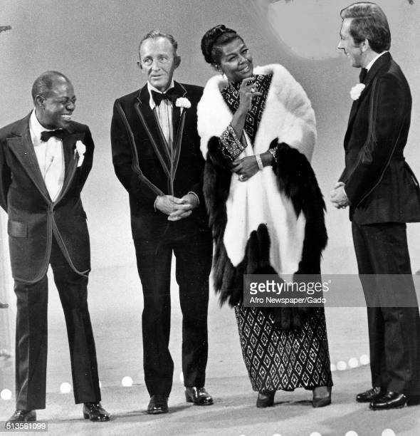 Louis Armstrong singer and actor Bing Crosby and Andy Williams standing and performing on stage during an episode of the Pearl Bailey Show 1960