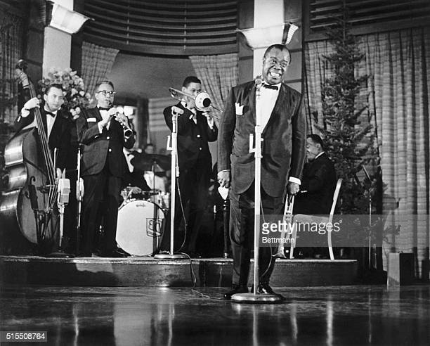 Louis Armstrong Singing on Stage with Band