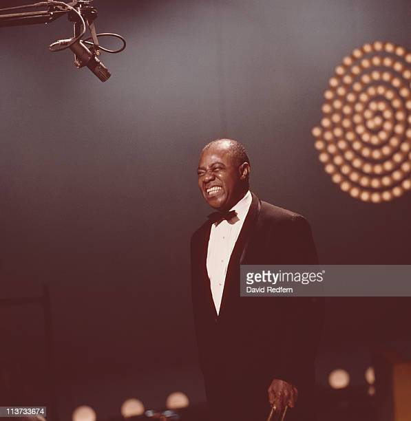 Louis Armstrong , U.S. Jazz singer and trumpeter, appearing on the 'Kraft Music Hall' television show, filmed at the NBC studios in New York City,...