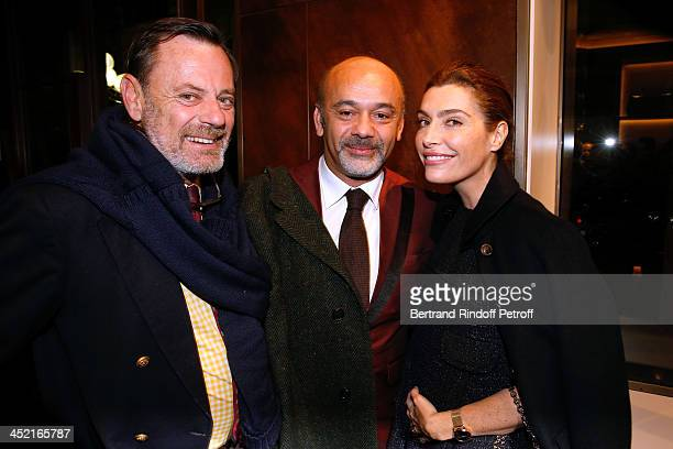 Louis Benech Christian Louboutin and journalist Daphne Roulier attend Berluti Flagship Store Opening on November 26 2013 in Paris France