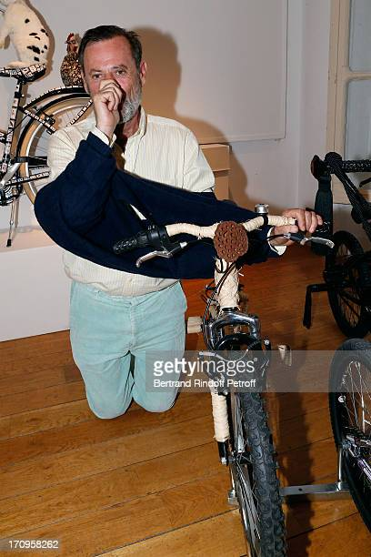 Louis Benech standing near his bike 'Pour partir aider grand-pere a palisser les palmettes des pommiers' at 'Arty Bike' Auction to benefit...