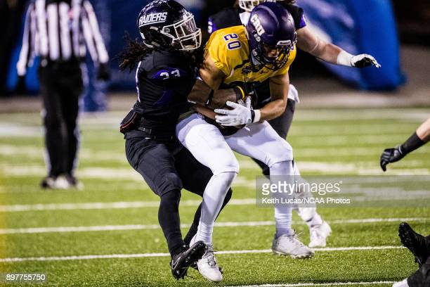 Louis Berry of the University of Mount Union attempts a tackle on Jonel Reed of the University of Mary HardinBaylor during the Division III Men's...