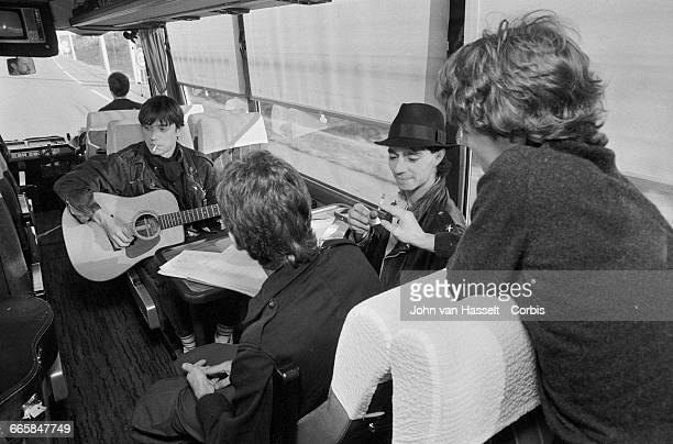 Louis Bertignac Corinne Marienneau Richard Kolinka and JeanLouis Aubert in the bus taking the rock group Telephone from town to town on tour France...