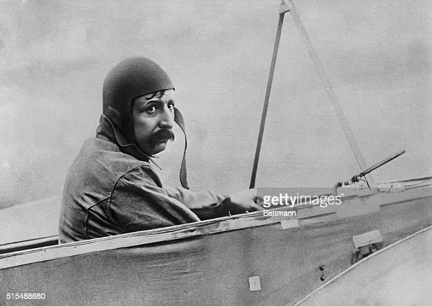 Louis Bleriot in the cockpit of his transchannel airplane twenty years ago