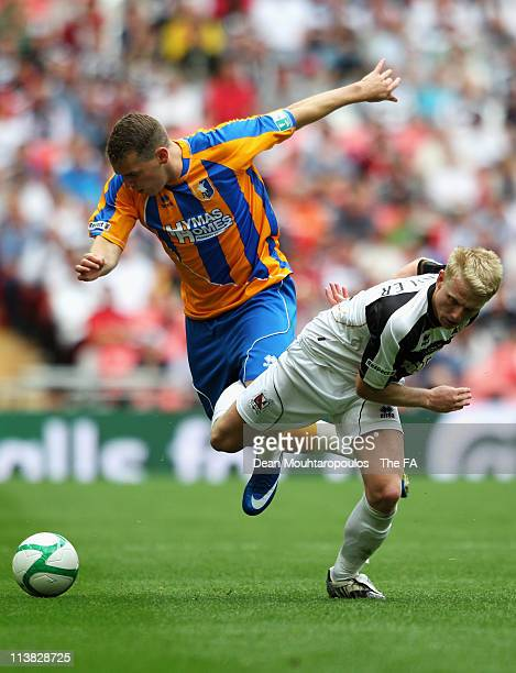Louis Briscoe of Mansfield battles for the ball with Jamie Chandler of Darlington during the FA Trophy Final between Darlington and Mansfield Town at...