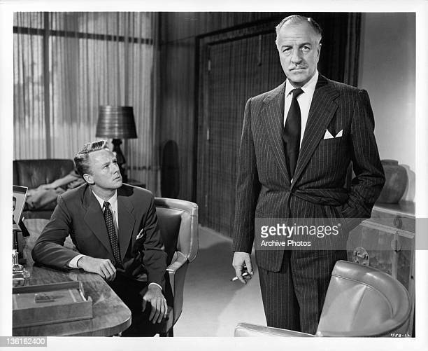 Louis Calhern makes marriage to his daughter a business proposition to Van Johnson in a scene from the film ' Invitation' 1952