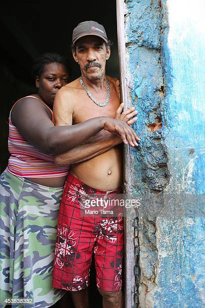 Louis Carlos de Sousa and Tania Gonzalves pose in the doorway of their home in the occupied Complexo da Mare one of the largest favela complexes in...