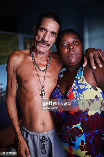 Louis Carlos de Sousa and Tania Gonzalves pose in their home in the unpacified Complexo da Mare slum complex one of the largest 'favela' complexes in...
