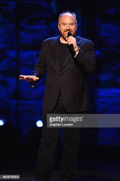 Louis CK performs on stage at Comedy Central Night Of Too Many Stars at Beacon Theatre on February 28 2015 in New York City