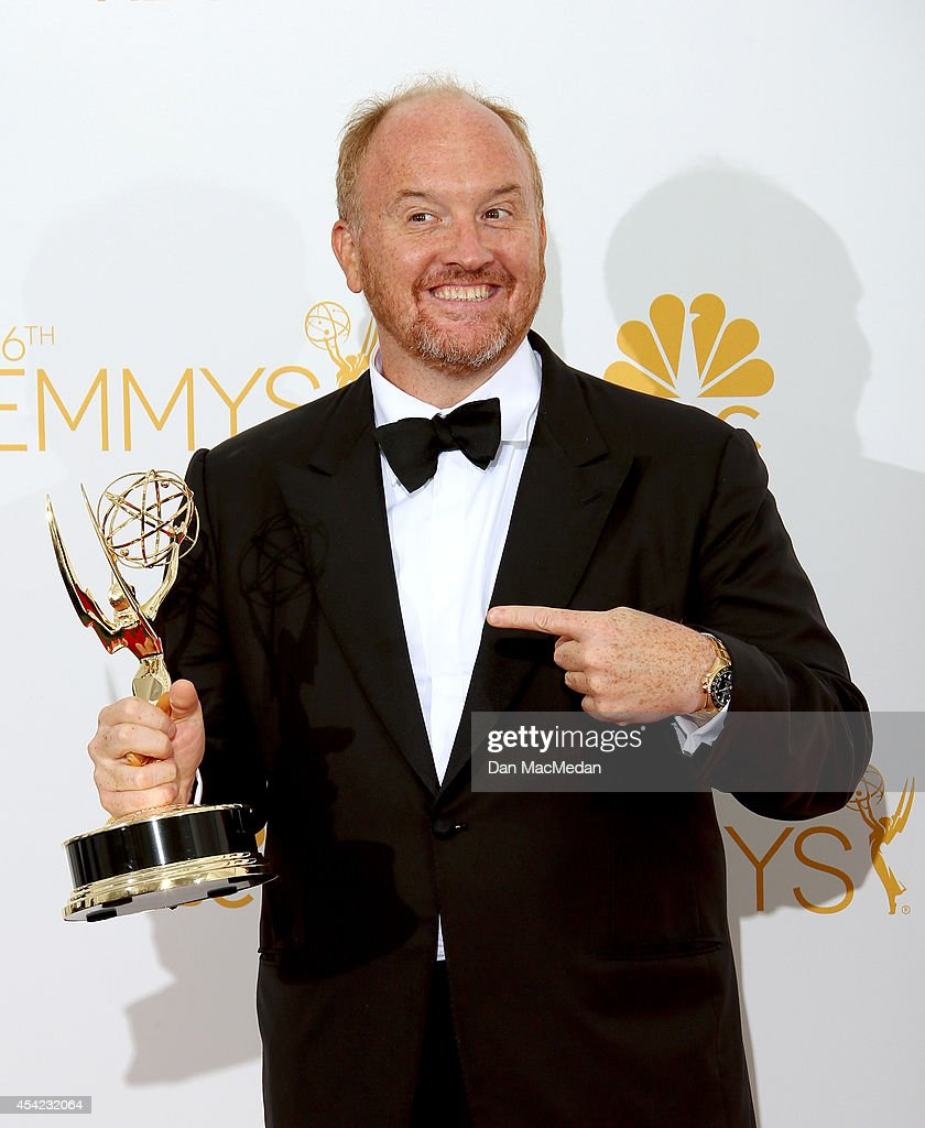 Louis C.K. poses in the photo room with his award for Outstanding Writing for a Comedy Series for 'Louie' at Nokia Theatre L.A. Live on August 25, 2014 in Los Angeles, California.