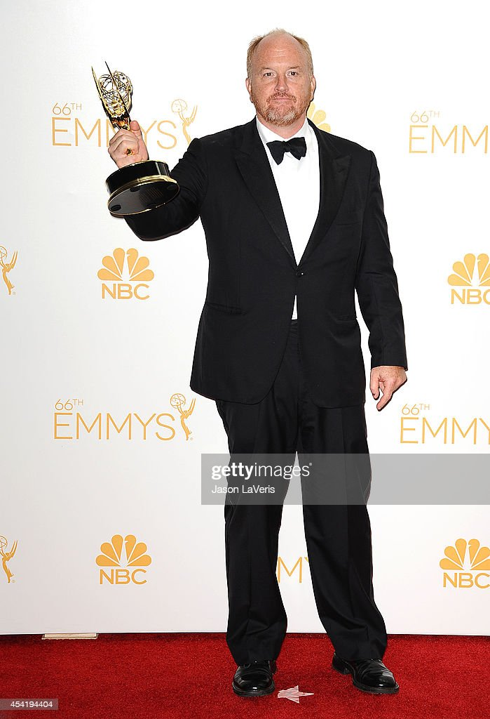 Louis C.K. poses in the press room at the 66th annual Primetime Emmy Awards at Nokia Theatre L.A. Live on August 25, 2014 in Los Angeles, California.