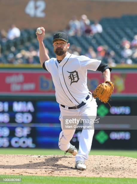 Louis Coleman of the Detroit Tigers pitches while wearing a special jersey shoes and hat to honor Memorial Day during the game against the Los...