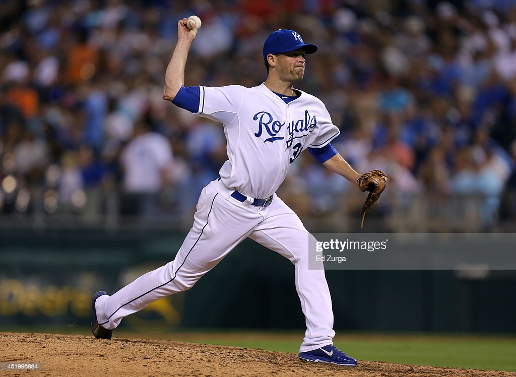 Louis Coleman #31 of the Kansas City Royals throws in the fifth inning against the Detroit Tigers at Kauffman Stadium on July 10, 2014 at Kauffman Stadium in Kansas City, Missouri.