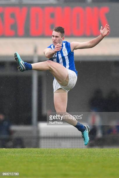 Louis Cunningham of North Melbourne kicks the ball during the VFL round 14 game between the Casey Demons and North Melbourne at Casey Fields in...