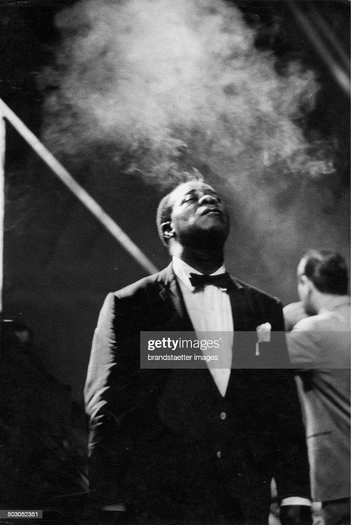 Louis Daniel Satchmo Armstrong Smoking. Stadthalle. Vienna. 1959. Vienna. Photograph By Franz Hubmann. : News Photo