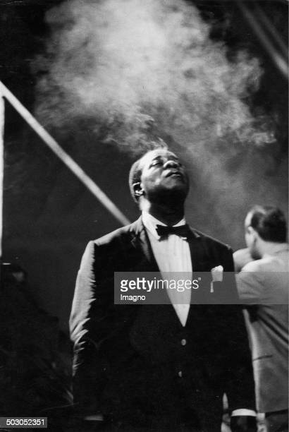 Louis Daniel Satchmo Armstrong smoking Stadthalle Vienna 1959 Vienna Photograph by Franz Hubmann