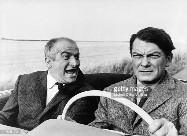 Louis de Funes and Jean Marais are on the trail of a criminal in a scene from the film 'Fantomas' 1964