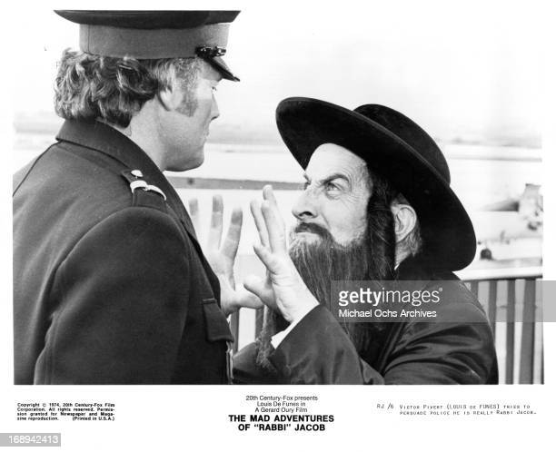 Louis De Funes attempts to persuade a guard in a scene from the film 'The Mad Adventures Of 'Rabbi' Jacob' 1973