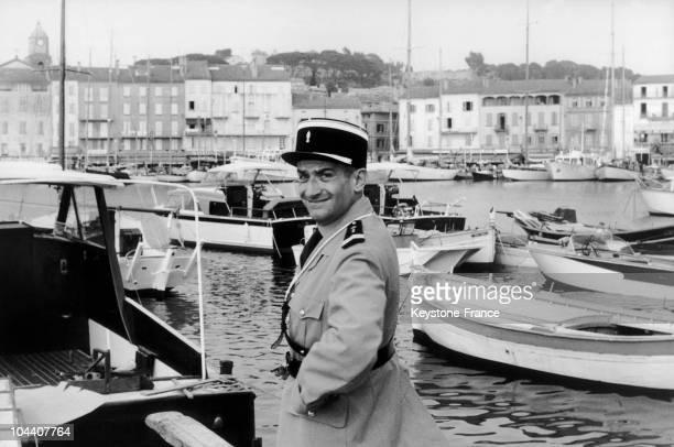Louis DE FUNES in the filming of LE GENDARME DE SAINTTROPEZ He is posing in the sea resort's harbour in SaintTropez