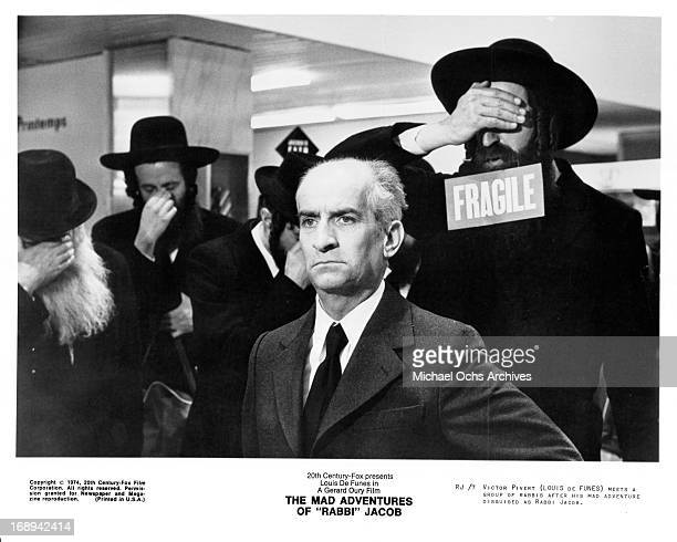Louis De Funes meets with a group of rabbis in a scene from the film 'The Mad Adventures Of 'Rabbi' Jacob' 1973