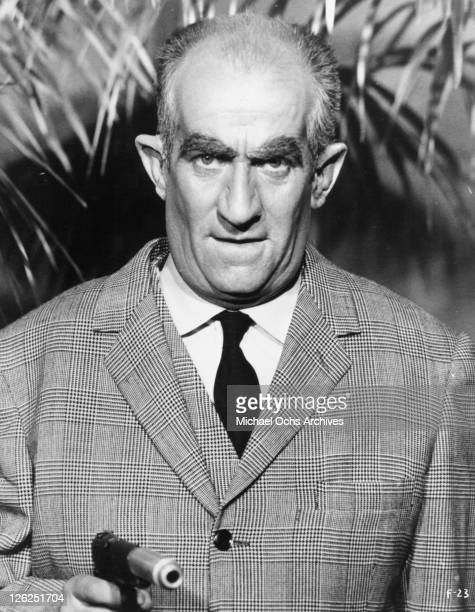 Louis de Funes pointing gun in a scene from the film 'Fantomas' 1964