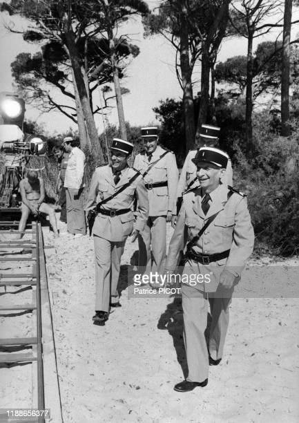 Louis de Funès Guy Grosso et Michel Modo sur le tournage du film 'Le Gendarme et les Extraterrestres' de Jean Girault à SaintTropez le 2 octobre 1978...