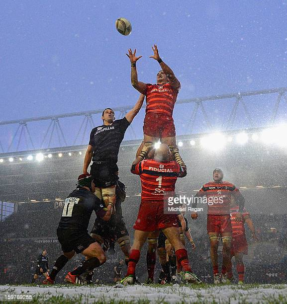 Louis Deacon of Leicester Tigers jumps for a line out with Yoann Maestri of Toulouse during the Heineken Cup match between Leicester Tigers and...