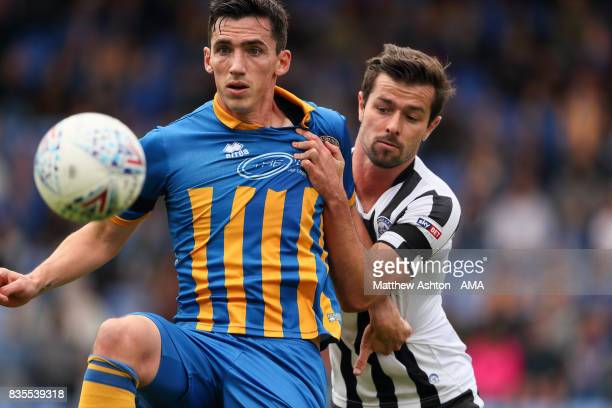Louis Dodds of Shrewsbury Town and Joe Rafferty of Rochdale during the Sky Bet League One match between Shrewsbury Town and Rochdale at New Meadow on...