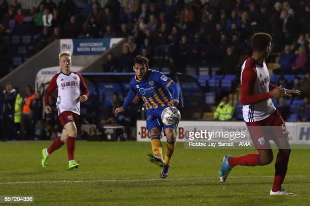 Louis Dodds of Shrewsbury Town scores a goal to make it 30 uring the EFL Checkatrade Trophy Northern Section Group B game between Shrewsbury Town v...