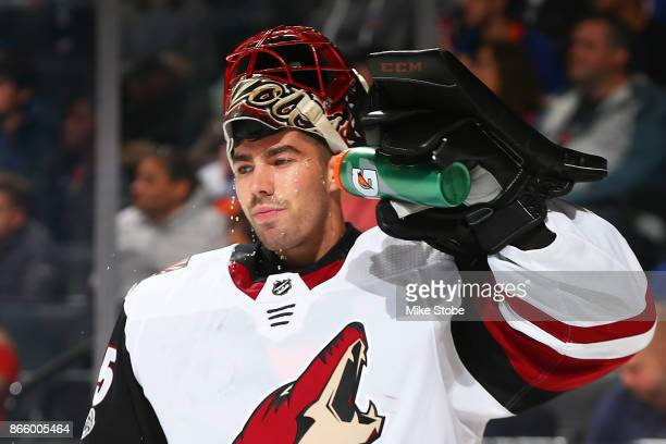 Louis Domingue of the Arizona Coyotes cools off during a game against the New York Islanders at Barclays Center on October 24 2017 in New York City
