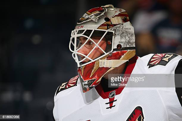 Louis Domingue of the Arizona Coyotes defends against the New York Islanders at the Barclays Center on October 21 2016 in Brooklyn borough of New...