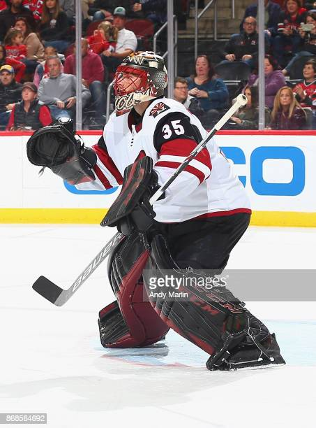 Louis Domingue of the Arizona Coyotes defends his net during the game against the New Jersey Devils at Prudential Center on October 28 2017 in Newark...