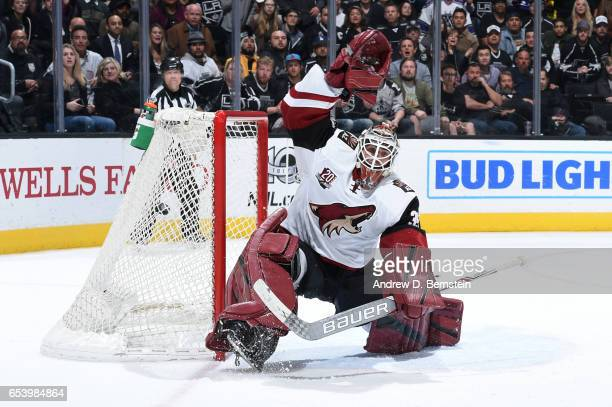 Louis Domingue of the Arizona Coyotes defends the goal during a game against the Los Angeles Kings at STAPLES Center on March 14 2017 in Los Angeles...