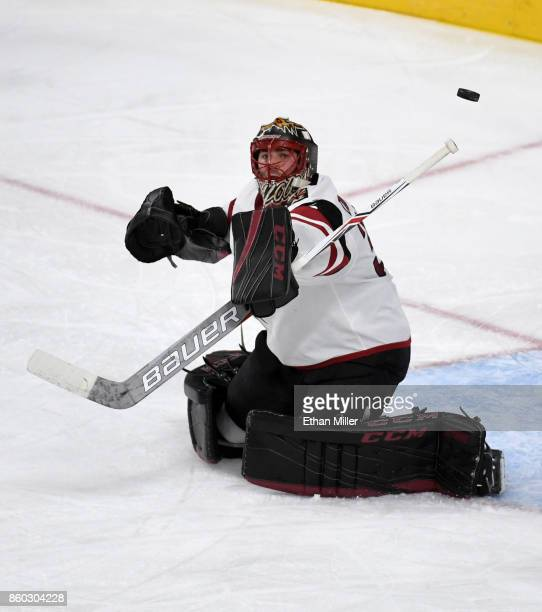 Louis Domingue of the Arizona Coyotes deflects a Vegas Golden Knights shot in the second period of the Golden Knights' inaugural regularseason home...
