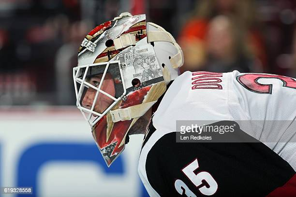 Louis Domingue of the Arizona Coyotes looks on against the Philadelphia Flyers on October 27 2016 at the Wells Fargo Center in Philadelphia...