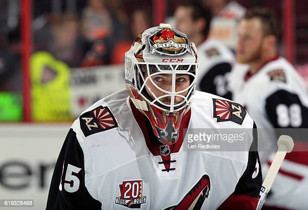 Louis Domingue of the Arizona Coyotes looks on during warmups prior to his game against the Philadelphia Flyers on October 27 2016 at the Wells Fargo...