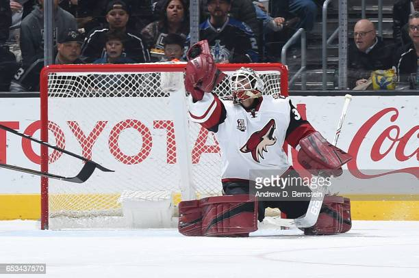 Louis Domingue of the Arizona Coyotes makes a save during a game against the Los Angeles Kings at STAPLES Center on March 14 2017 in Los Angeles...