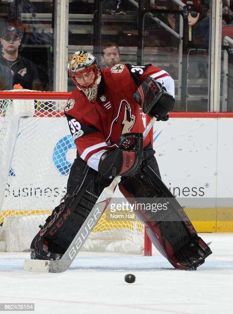 Louis Domingue of the Arizona Coyotes passes the puck against the Boston Bruins at Gila River Arena on October 14 2017 in Glendale Arizona