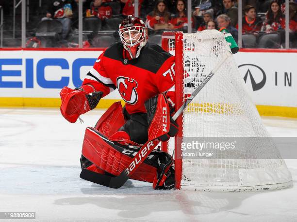 Louis Domingue of the New Jersey Devils watches the game action during the second period against the Montreal Canadiens on February 4 2020 in Newark...