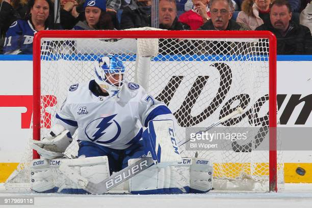 Louis Domingue of the Tampa Bay Lightning deflects a shot during an NHL game against the Buffalo Sabres on February 13 2018 at KeyBank Center in...