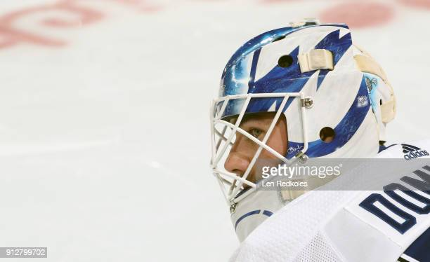 Louis Domingue of the Tampa Bay Lightning looks on during warmups against the Philadelphia Flyers on January 25 2018 at the Wells Fargo Center in...