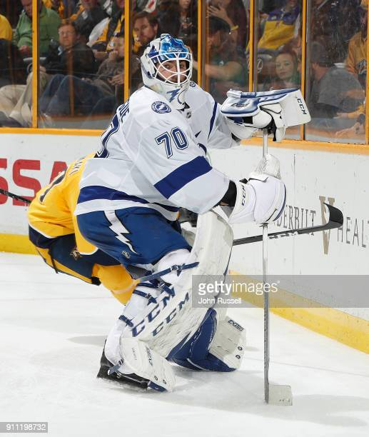 Louis Domingue of the Tampa Bay Lightning plays the puck against the Nashville Predators during an NHL game at Bridgestone Arena on January 23 2018...