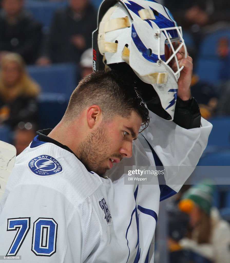 Louis Domingue #70 of the Tampa Bay Lightning removes his goaltender's mask during an NHL game against the Buffalo Sabres on February 13, 2018 at KeyBank Center in Buffalo, New York. Buffalo won, 5-3.