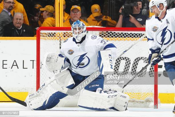 Louis Domingue of the Tampa Bay Lightning tends net against the Nashville Predators during an NHL game at Bridgestone Arena on January 23 2018 in...