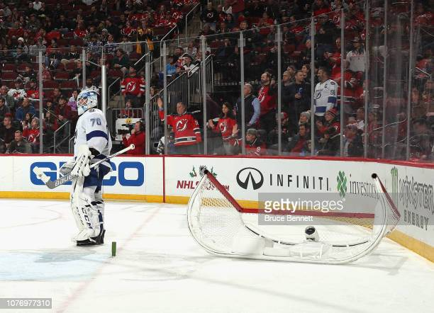 Louis Domingue of the Tampa Bay Lightning waits for the net to be set back on it's pegs during the second period against the New Jersey Devils at the...