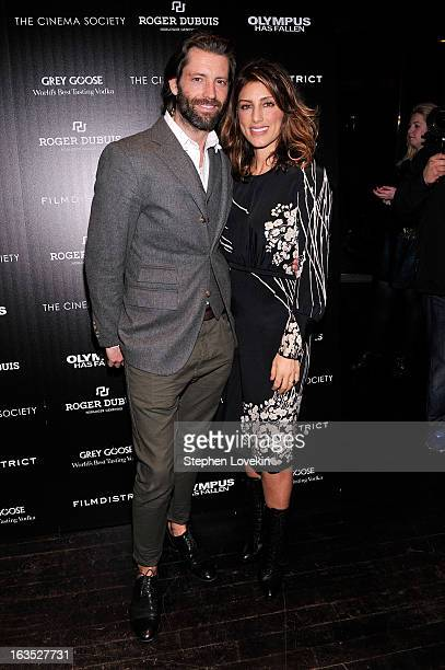 Louis Dowler and actress Jennifer Esposito attend The Cinema Society with Roger Dubuis and Grey Goose screening of FilmDistrict's Olympus Has Fallen...