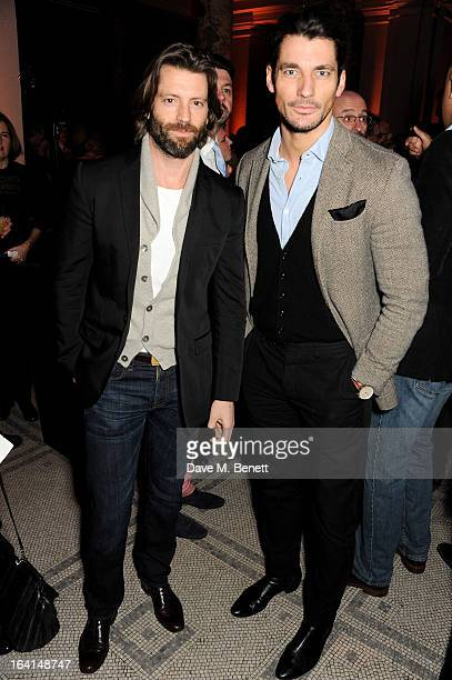 Louis Dowler and David Gandy attend the private view for the 'David Bowie Is' exhibition in partnership with Gucci and Sennheiser at the Victoria and...