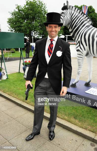 Louis Dowler attends Investec Derby Day at the Investec Derby Festival the first official event of the Queen's Diamond Jubilee weekend at Epsom Downs...