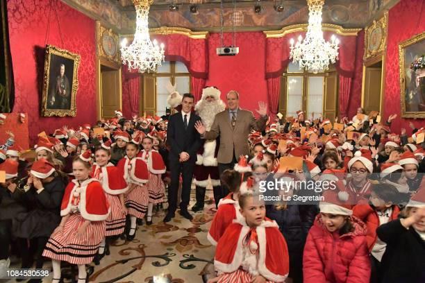 Louis Ducruet and Prince Albert II of Monaco attend the Christmas Gifts Distribution on December 19 2018 in Monaco Monaco